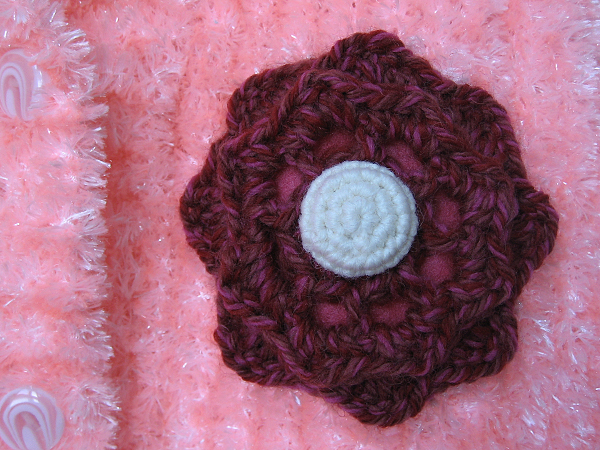 hand knit sweater with crochet flower applique