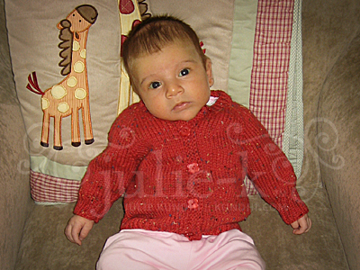 mirabella in her red sweater