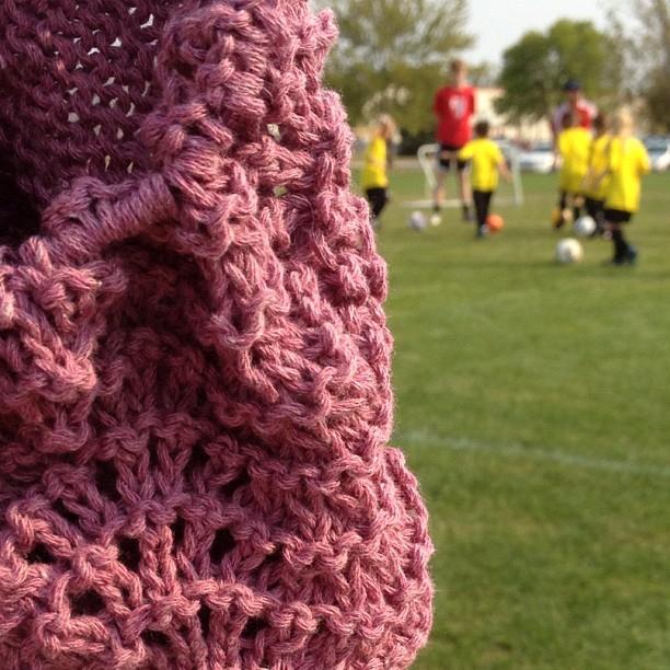 knitting boheme baby sweater at soccer practice